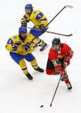 2018 Ice Hockey U18 World Championship Div 1, Kyiv, Ukraine. KYIV, UKRAINE - APRIL 17, 2018: Bence DEZSI of Hungary Red fights for a puck with Danylo BABCHUK and Stock Image