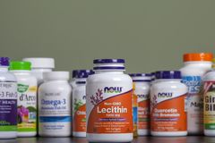 KYIV, UKRAINE - April 24, 2018 Bottle of lecithin in capsules. Some bottles of vitamins and dietary supplements are behind it. Stu. KYIV, UKRAINE - April 24 royalty free stock image