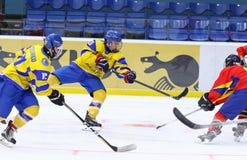 IIHF 2018 Ice Hockey U18 World Championship Div 1B. KYIV, UKRAINE - APRIL 20, 2018: Dmytro DANYLENKO of Ukraine shots a puck during the IIHF 2018 Ice Hockey U18 royalty free stock photography