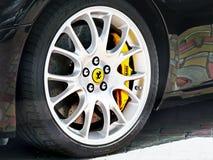 Kyiv, Ukraine, April 4, 2015. Emblem of Ferrari. Horse. Car tires. Car wheel close-up stock images