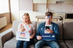KYIV, UKRAINE - APRIL 25, 2019: Facebook logo. illustration. Facebook icon. Young man and woman have social media