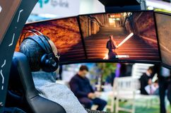 Kyiv, Ukraine - April 12, 2019: Man are playing a video game in the Acer Predator Thronos royalty free stock photos