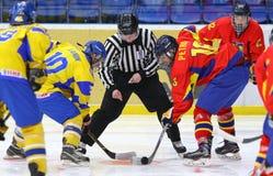 IIHF 2018 Ice Hockey U18 World Championship Div 1B. KYIV, UKRAINE - APRIL 20, 2018: Referee face-off the rink during the IIHF 2018 Ice Hockey U18 World stock photography