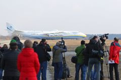 Antonov An-225 Mriya aircraft at Gostomel Airport, Kiev, Ukraine. KYIV, UKRAINE - APRIL 3,2018: Reporters looks on the Antonov An-225 `Mriya` aircraft during it` Royalty Free Stock Images