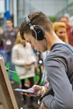 People visit Sony headphones booth during CEE 2019 in Kyiv Ukraine. KYIV, UKRAINE - APRIL 06, 2019: Unrecognized people visit Sony headphones, electronics royalty free stock photography