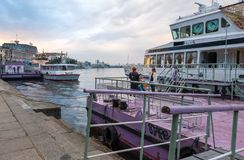 Women near the tourist boat on the embankment of Dnieper River near the River Port on Poshtova Square of Kyiv, Ukraine. Kyiv, Ukraine - April 28, 2019: Women royalty free stock photography