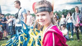 Kyiv, Ukraine - 07.09.2019: Atlas Weekend music festival outdoors, first day. Lettle girl are having fun at the festival stock images