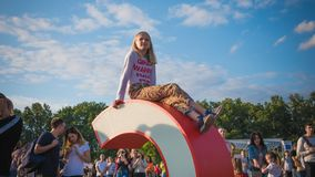 Kyiv, Ukraine - 07.09.2019: Atlas Weekend music festival outdoors, first day. Lettle girl are having fun at the festival royalty free stock images