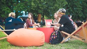 Kyiv, Ukraine - 07.09.2019: Atlas Weekend music festival outdoors, first day. Millennials are relaxin at music festival royalty free stock photography