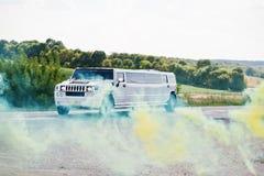 Free Kyiv, Ukraine - August 31: Elegance White Wedding Limousine Hummer H2 Ride Background Colour Smoke From Smokes Bomb At Wedding Da Stock Photo - 80828810