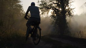 KYIV, UKRAINE - AUGUST 16, 2015: Mature male cyclist rides through DVRZ forest stock footage