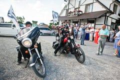 Kyiv, Ukraine - August 31: Two bikers accompanying wedding limou Stock Photo
