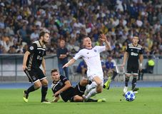 UEFA Champions League play-off: FC Dynamo Kyiv v Ajax. KYIV, UKRAINE - AUGUST 28, 2018: Viktor Tsygankov of FC Dynamo Kyiv R fights for a ball with AFC Ajax royalty free stock photo