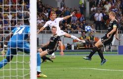 UEFA Champions League play-off: FC Dynamo Kyiv v Ajax. KYIV, UKRAINE - AUGUST 28, 2018: Vladyslav Supriaha of FC Dynamo Kyiv in White kicks a ball during the Stock Image