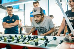 KYIV, UKRAINE, bar league of Grants KickerKicker 10 June 2018. Active men and women have fun during table soccer game stock images