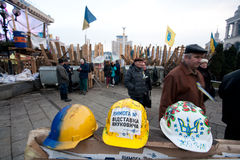 KYIV, UKRAINE: Bright helmets participants anti-government revolution inside the camp of protesters Stock Photo