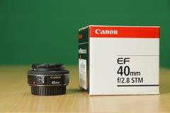 Canon Lens 40mm Box. KYIV, UKRAINE - 02 23 2016: Canon EF 40mm f2.8 STM pancake lens unboxing Stock Photography