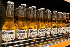 Kyiv, Ukraine - December 19, 2018: Corona extra beer bottles on shelves in a supermarket. Corona Extra is a pale lager produced by. Cervecería Modelo in royalty free stock photo