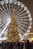 The Ferris wheel and christmas tree at the Kontraktova Square on Podil. Christmas Market in Kyiv, Ukraine. Kyiv, Ukraine - December 22, 2018: The Ferris wheel stock images