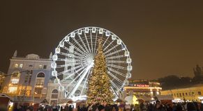 The Ferris wheel and christmas tree at the Kontraktova Square on Podil. Christmas Market in Kyiv, Ukraine. Kyiv, Ukraine - December 22, 2018: The Ferris wheel stock photos
