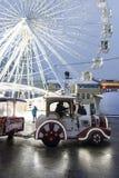 The Ferris wheel and fabulous car at the Kontraktova Square on Podil. Christmas Market in Kyiv, Ukraine. Kyiv, Ukraine - December 15, 2018: The Ferris wheel and stock photography