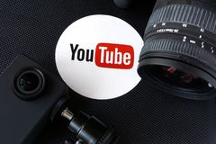 KYIV, UKRAINE - December 07, 2016: Youtube logo on a box and cameras. Video blog concept stock image