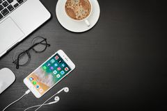 Apple iPhone 8 plus with social network apps. Kyiv, Ukraine - Fabruary 6, 2018: Apple iPhone 8 plus with social network apps on the screen with macbook, coffee Royalty Free Stock Images