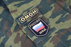 KYIV, UKRAINE - Feb. 25, 2017. OMON - Russian Riot Police uniform badge. Background stock photos