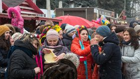 The celebration of the Maslenitsa Shrovetide in the city. Traditional eating pancakes stock photo