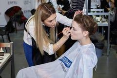 Kyiv, Ukraine - February 6, 2017: Makeup artist at work. Backsta Royalty Free Stock Image