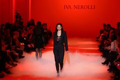 Ukrainian Fashion Week FW18-19: collection by Iva Nerolli. KYIV, UKRAINE - FEBRUARY 5, 2018: Models present a creation by designer Iva Nerolli during 42nd stock images
