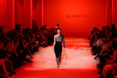 Ukrainian Fashion Week FW18-19: collection by Iva Nerolli. KYIV, UKRAINE - FEBRUARY 5, 2018: Models present a creation by designer Iva Nerolli during 42nd stock photos