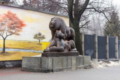 Kyiv, Ukraine - February 03, 2019: Kyiv zoo. The central entrance to the zoo. Statue of a pair of lions.  royalty free stock image