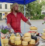 20.05.2018 Kyiv, Ukraine. Handsome cheese vendor at traditional Stock Photography