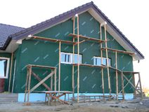 Building New House with Plastic Siding and Insulation Membrane on House Construction Wall. KYIV, UKRAINE - May 18, 2019:   Building New House with Plastic Siding stock image