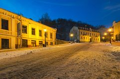 An early morning view of colourful buildings on empty Andriyivskyy Uzvoz Descent or Spusk. One of the oldest street in Kyiv. KYIV, UKRAINE-JANUARY 21, 2018: An stock photography