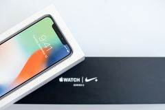 KYIV, UKRAINE - 26 JANUARY, 2018: New Iphone X smartphone model and apple watch in boxes close up. Newest Apple devices Stock Photo