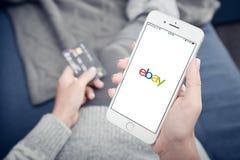 Apple Iphone 8 plus with loading Ebay mobile app. Kyiv, Ukraine - January 24, 2018: Woman holding Apple Iphone 8 plus with loading Ebay mobile app at home Stock Images