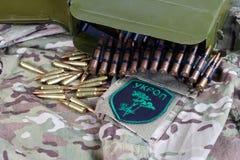 KYIV, UKRAINE - July, 08, 2015. Ukraine Army unofficial uniform badge. `UKROP` with military ammunition Stock Images