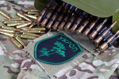 KYIV, UKRAINE - July, 08, 2015. Ukraine Army unofficial uniform badge. `UKROP` with military ammunition Royalty Free Stock Photos