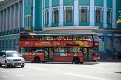 KYIV, UKRAINE JUNE 26, 2018: A red double-decker bus is a hop-hop bus for sightseeing in Kiev. KYIV, UKRAINE JUNE 26, 2018: Attractive teenage girl roller stock photos