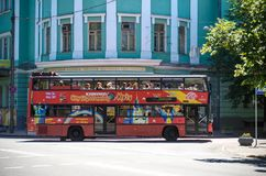 KYIV, UKRAINE JUNE 26, 2018: A red double-decker bus is a hop-hop bus for sightseeing in Kiev. KYIV, UKRAINE JUNE 26, 2018: Attractive teenage girl roller stock photography