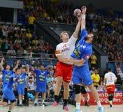 EHF EURO 2020 Qualifiers handball game Ukraine v Denmark. KYIV, UKRAINE - JUNE 12, 2019: Johan a Plogv HANSEN of Denmark L fights for a ball with Evgeniy stock photo