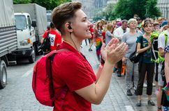 Kyiv, Ukraine - June 23, 2019. March of equality. KyivPride. The girl in red coordinates the action of the marchers royalty free stock photography