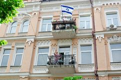 Kyiv, Ukraine - June 23, 2019. March of equality. LGBT march KyivPride. Gay parade. Israeli flag on the balcony royalty free stock photography