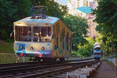 Nature landscape with the Kyiv Funicular. Cabins with passengers goings towards to each other.