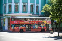 KYIV, UKRAINE JUNE 26, 2018: A red double-decker bus is a hop-hop bus for sightseeing in Kiev. KYIV, UKRAINE JUNE 26, 2018: Attractive teenage girl roller stock image