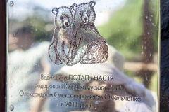 KYIV, UKRAINE - June 15, 2017: A sign with a description of the Potap and Nastya bears in the Kiev Zoo. KYIV, UKRAINE - June 15, 2017: A sign with a description stock images