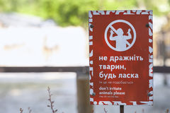 KYIV, UKRAINE - June 15, 2017: a sign with the rules of conduct in the Kiev Zoo. An inscription in the Ukrainian language urging n. KYIV, UKRAINE - June 15, 2017 royalty free stock photos