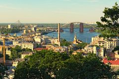 Stunning landscape view of ancient Podil neighborhood. River Dnipro with several bridges at the background